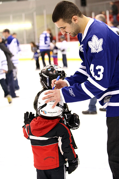 Kadri signs a skaters helmet at last years event